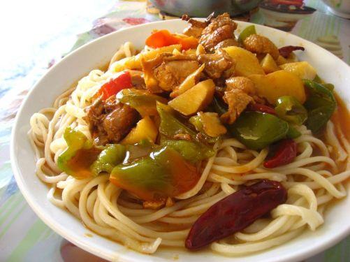 """""""Dapanji""""(stewed chicken) laghman served in a cafe near Hotan."""